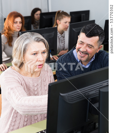Mature man and woman learning to use computer 53770302