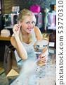Woman choosing earrings in jewellery boutique 53770310