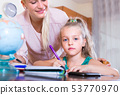 teacher and girl studying at home 53770970