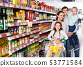 Couple with children buying food in hypermarket. 53771584