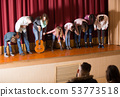Performing people bowing to audience 53773518