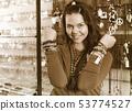 Girl seller offering fashionable bracelets and pendants 53774527