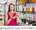 Woman buying liquid soap 53774831