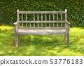 Ancient wooden bench in a garden 53776183