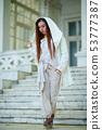 dreadlocks fashionable girl dressed in white 53777387