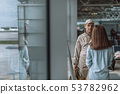 American sad soldier looking at woman while standing indoors 53782962