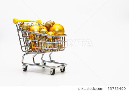 Shopping trolley full of gold Christmas balls 53783490