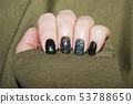 beautiful green manicure, nail polish on nails of 53788650