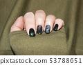 beautiful green manicure, nail polish on nails of 53788651