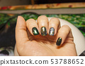 beautiful green manicure, nail polish on nails of 53788652