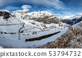 snowy Pyrenees mountains with small winding road 53794732
