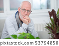 portrait of middle-aged man with beard and glasses 53794858