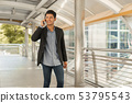 Portrait of young businessman standing at Outside 53795543