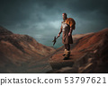 Handsome viking with axe on the top of mountain 53797621