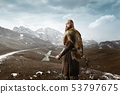 Viking with axes in hands at the rocky mountains 53797675