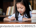 cute girl smile sitdown and playing laptop 53800025