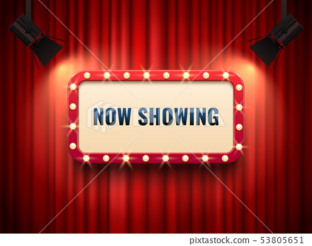 Retro cinema or theater frame illuminated by spotlight. Now showing sign on red curtain backdrop 53805651