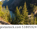 George Dam of the Skagit River surrounded by mountains and forest 53805924