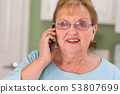 Happy Senior Adult Woman on Her Smart Cell Phone 53807699