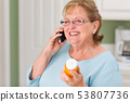 Senior Adult Woman on Cell Phone Holding 53807736