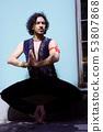Bollywood dancer with beard and black curly hair 53807868