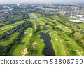 Aerial panoramic view of golf course and houses in 53808759