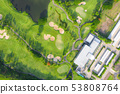 Aerial panoramic view of golf course and houses in 53808764