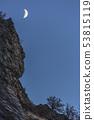 Crescent moon over valley in Utah Valley 53815119