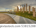 A sunset behind wooden pillars and playground 53815288