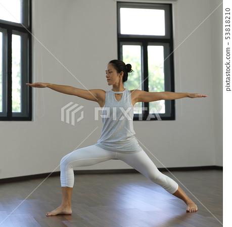 Asian chinese single woman practising Yoga low key 53818210