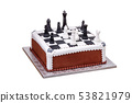Cake on holiday chess pieces on the board from black and white cream. 53821979