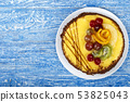 Delicious fruit cake on a blue background. 53825043