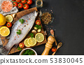 Fresh fish seabass and ingredients for cooking. 53830045