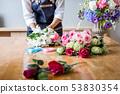 Arranging artificial flowers vest decoration at 53830354