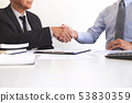 Real estate agent and customers shaking hands 53830359