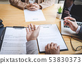 Two selection committee manager reading a resume 53830373