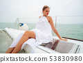 Young beautiful Caucasian woman smiling and looking away on yacht sailboat 53830980