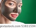 Beautiful joyful girl using clay facial mask 53831594