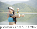 Portrait of beautiful young woman exercising in 53837942