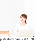A young woman using a computer 53840203