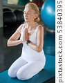 Senior woman Doing yoga in fitness gym. aged lady 53840395