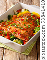 Spicy baked salmon fillet with vegetables and 53841410