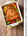 baked salmon with summer vegetables close-up in a 53841416