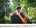 Happy couple love and hug together in nature 53843377
