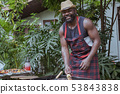 Smiling chef with barbecue dinner camping in 53843838