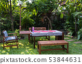 settle wooden table outdoor and red plate with 53844631
