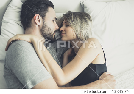 Loving happy couple in love smile and hug each 53845070