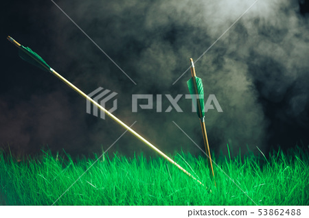 Two wooden arrows in the grass. Beautiful smog 53862488