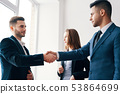 Business people shaking hands after good deal 53864699