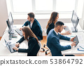 Top view of business people working on computer in modern office 53864792